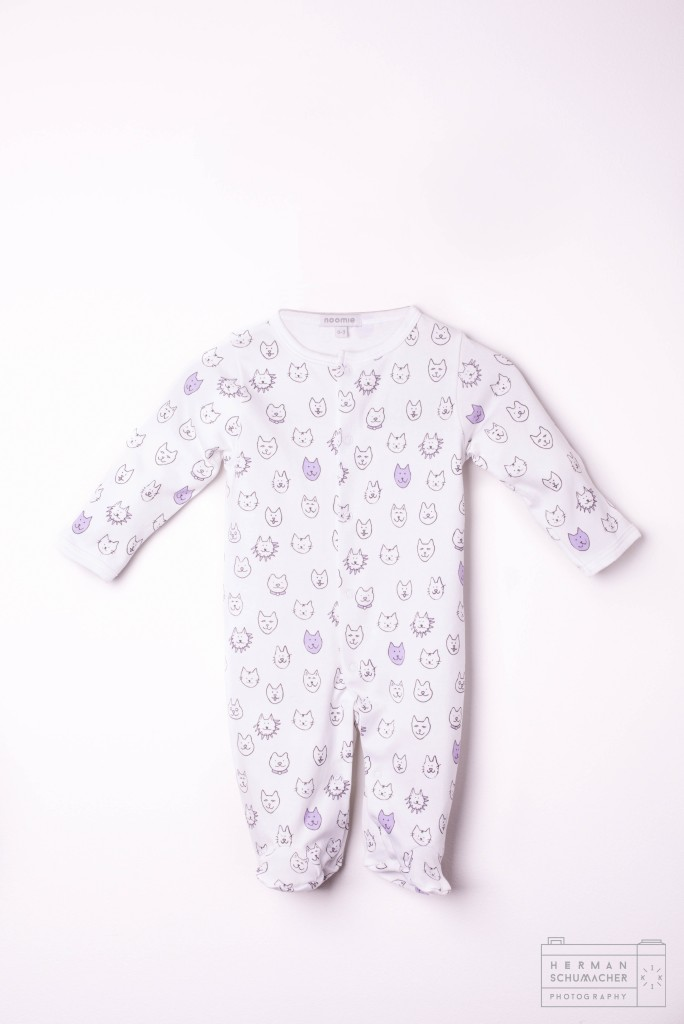 white baby noomie onesie with cats and lions