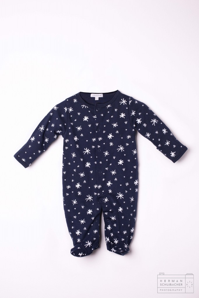 navy blue baby noomie onesie with cats and lions